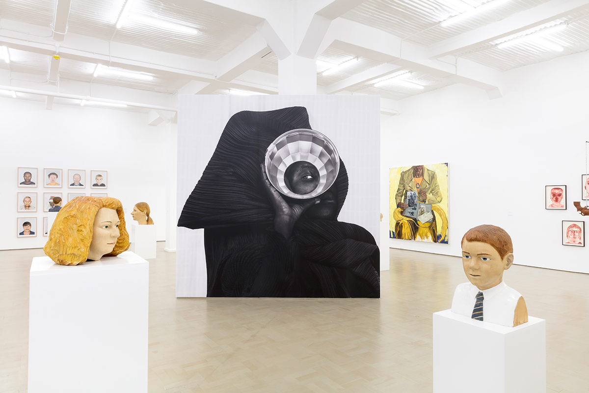 Installation view with works by Claudette Schreuders in foreground and Zanele Muholi in centre