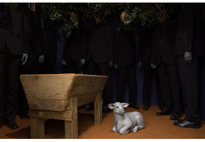 """'Nativity' with detail in polyester suits and industrial footwear (""""beyond safety"""")"""